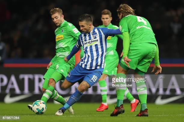 Vedad Ibisevicof Berlin shoots past Jannik Vestergaard of Moenchengladbach during the Bundesliga match between Hertha BSC and Borussia...