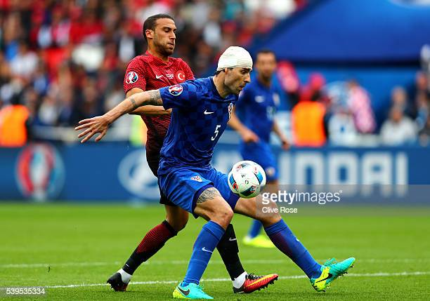 Vedran Corluka of Croatia controls the ball under pressure of Cenk Tosun of Turkey during the UEFA EURO 2016 Group D match between Turkey and Croatia...