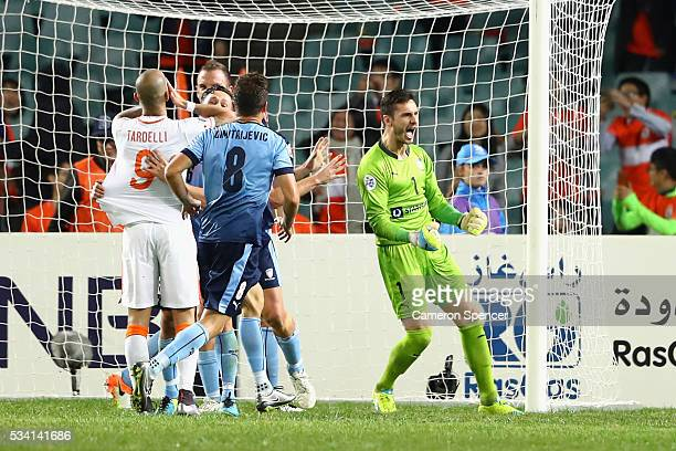 Vedran Janjetovic of Sydney FC celebrates saving a penalty during the AFC Asian Champions League match between Sydney FC and Shandong Luneng at...