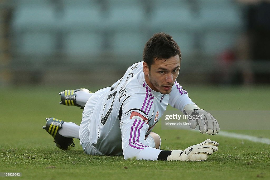 Vedran Janjetovic of Sydney lies on the ground after making a save during the round 14 A-League match between Adelaide United and Sydney FC at Hindmarsh Stadium on December 31, 2012 in Adelaide, Australia.