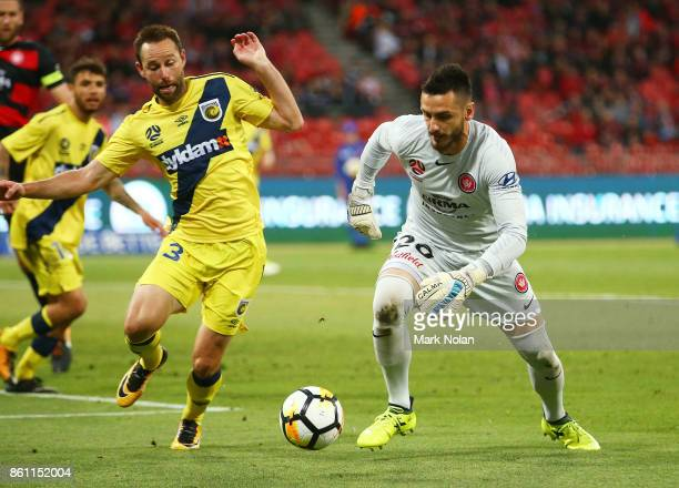 Vedran Janjetovic of the Wanderers and Joshua Rose of the Mariners contest possession during the round two ALeague match between the Western Sydney...