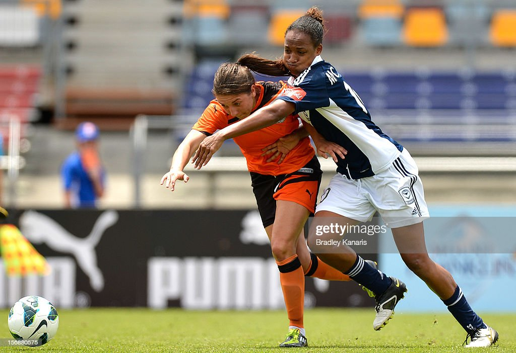 Vedrana Popovic of the Roar and Jessica McDonald of the Victory compete for the ball during the round six W-League match between the Brisbane Roar and the Melbourne Victory at the Queensland Sport and Athletics Centre on November 24, 2012 in Brisbane, Australia.