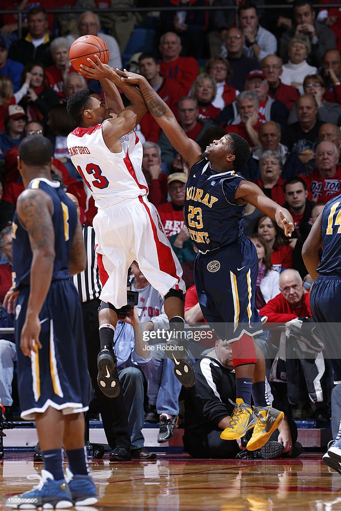 Vee Sanford #43 of the Dayton Flyers gets fouled while shooting the ball against Dexter Fields #23 of the Murray State Racers during the game at University of Dayton Arena on December 22, 2012 in Dayton, Ohio. The Flyers won 77-68.