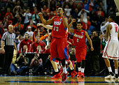 Vee Sanford of the Dayton Flyers reacts after defeating the Ohio State Buckeyes 6059 in the second round of the 2014 NCAA Men's Basketball Tournament...