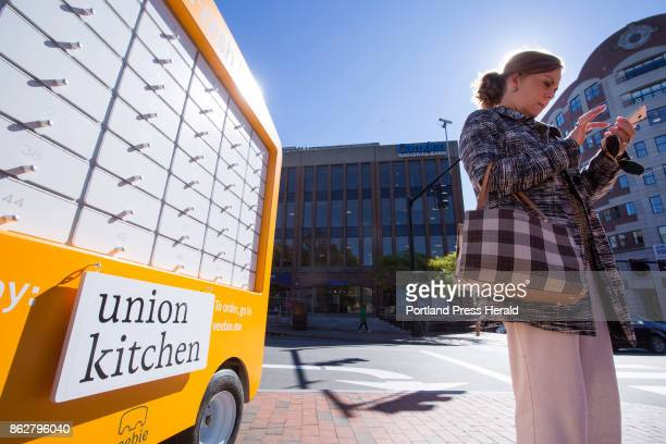 Veebie a mobile freshfood kiosk at the corner of Middle and Temple streets Terri Stevens who works in the Old Port orders her lunch from her phone on...