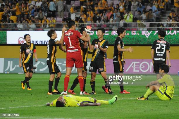 Vegalta Sendai players celebrate while Anderson Lopes and Yusuke Chajima of Sanfrecce Hiroshima show dejection after the JLeague J1 match between...