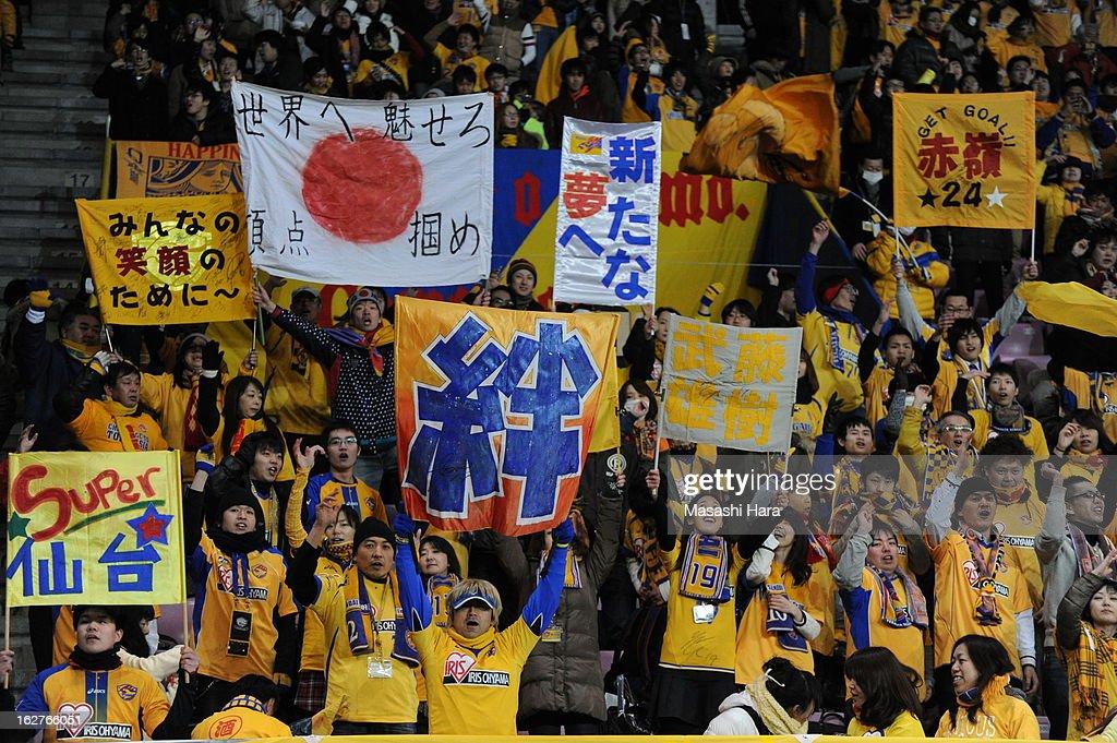Vegalta Sendai supporters hold flags prior to the AFC Champions League Group E match between Vegalta Sendai and Buriram United at Sendai Stadium on February 26, 2013 in Sendai, Japan.