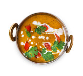 Vegan and vegetarian dish, spicy lentil dahl soup bowl. Indian cuisine, masala hot dal meal isolated on white background. Eastern local cuisine restaurant food top view