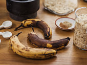 Vegan banana bread and ingredients with over ripe bananas