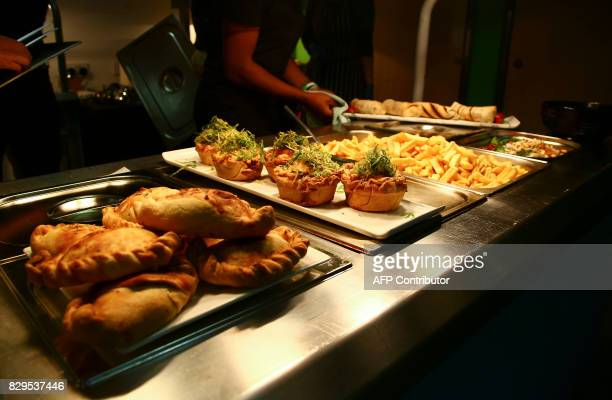 Vegan food is served inside the The New Lawn stadium in Nailsworth western England on August 8 ahead of the EFL Cup football match between Forest...