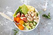 buddha bowl, vegan lunch, tofu fruit vegetables salad.