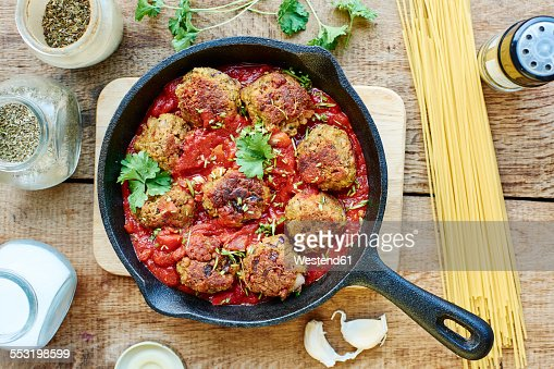 Vegan meatless balls in tomato sauce in a cast iron pan