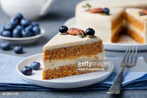 Vegan, raw carrot cake. Healthy food. Grey background : Stock Photo