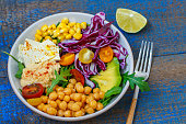Vegan salad with hummus, tofu, chickpeas and vegetables. Love for a healthy vegan food concept