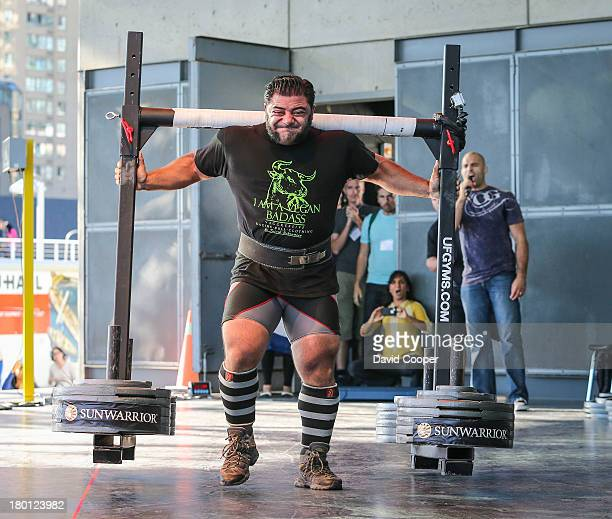 Vegan strongman Patrik Baboumian breaks a world record by carrying 555 kilos 10 metres on the West Jet stage at the Harbourfront Centre