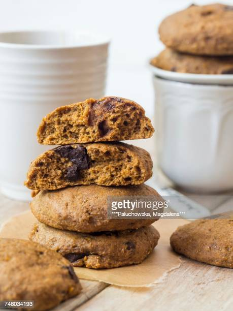 Vegan wholemeal spelt pumpkin cookies with chocolate chips with tea