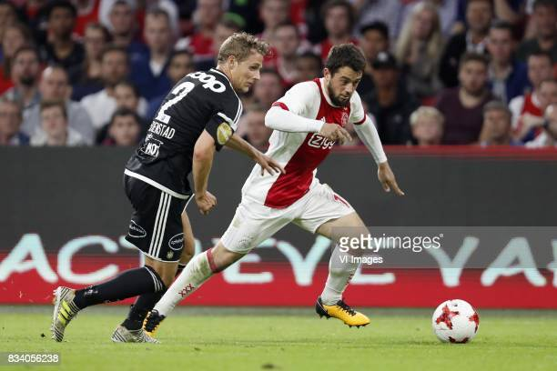 Vegar Eggen Hedenstad of Rosenborg BK Amin Younes of Ajax during the UEFA Europa League fourth round qualifying first leg match between Ajax...