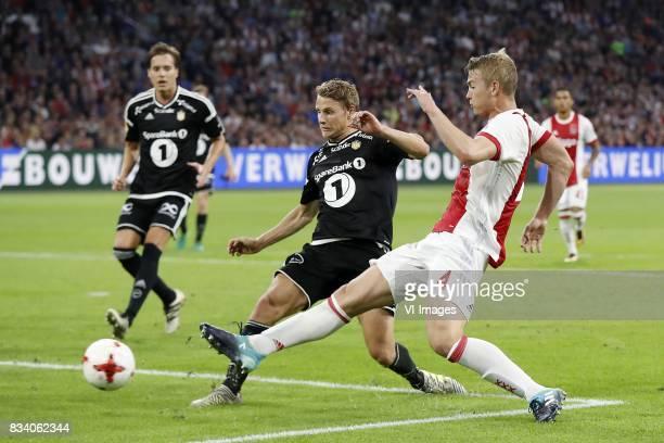 Vegar Eggen Hedenstad of Rosenborg BK Matthijs de Ligt of Ajax during the UEFA Europa League fourth round qualifying first leg match between Ajax...
