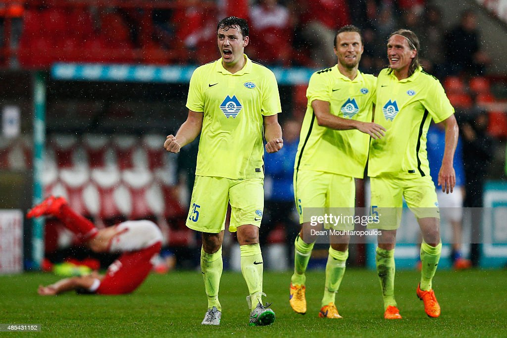 Vegard Forren Daniel Berg Hestad and Per Egil Flo of Molde FK celebrate after victory in the UEFA Europa League play off round second leg match...