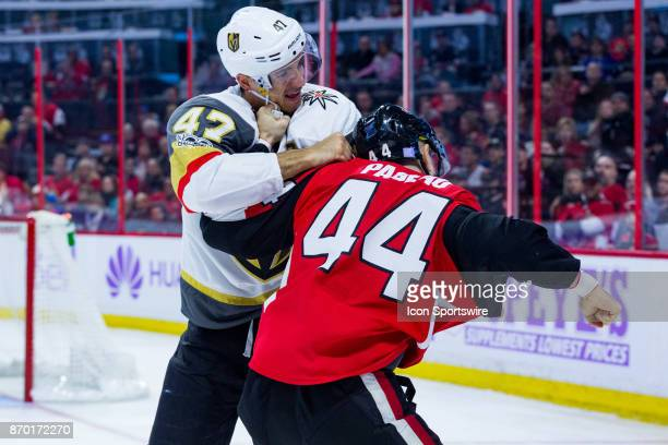 Vegas Golden Knights Defenceman Luca Sbisa and Ottawa Senators Center JeanGabriel Pageau grapple as they attempt to fight during first period...