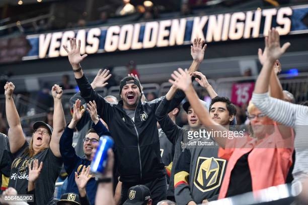 Vegas Golden Knights fans cheer on their team against the San Jose Sharks during the game at TMobile Arena on October 1 2017 in Las Vegas Nevada ***...
