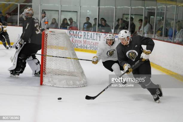 Vegas Golden Knights Forward Nick Suzuki clears the puck from behind the net during a joint scrimmage at the Vegas Golden Knights Development Camp on...
