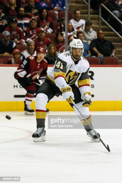 Vegas Golden Knights left wing PierreEdouard Bellemare tries to control the puck during the NHL hockey game between the Vegas Golden Knights and the...