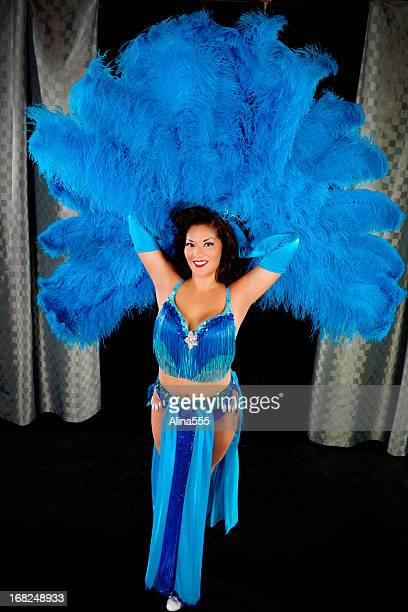 Vegas showgirl with blue feathers