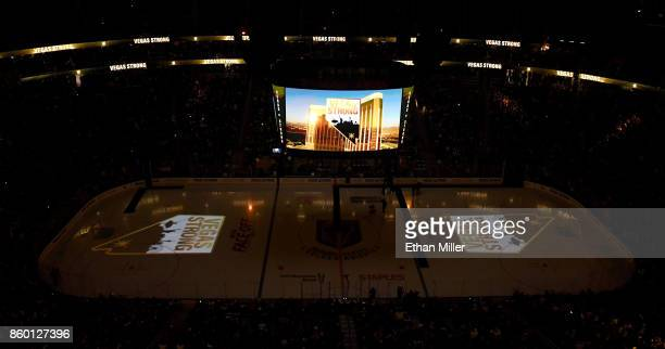 Vegas Strong logos are projected on the ice and shown on the scoreboard before the Vegas Golden Knights' inaugural regularseason home opener against...
