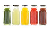 vegetable and fruit juice bottles isolated on white background