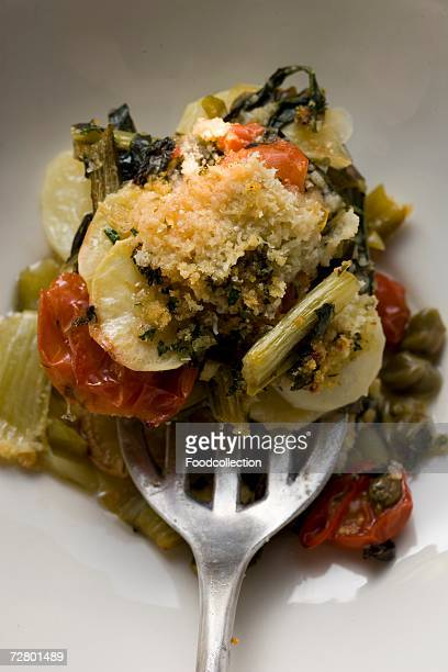 Vegetable bake with potatoes, tomatoes, leeks and capers