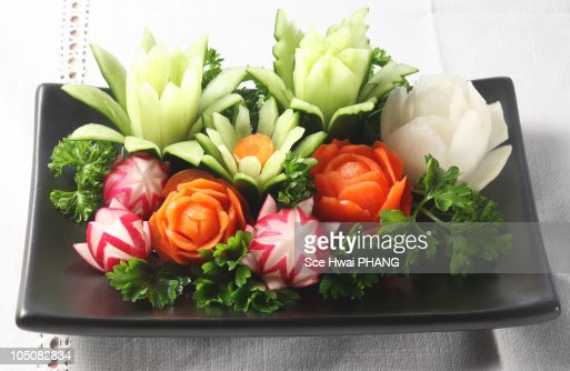 Vegetable carving edible flowers stock photo getty images