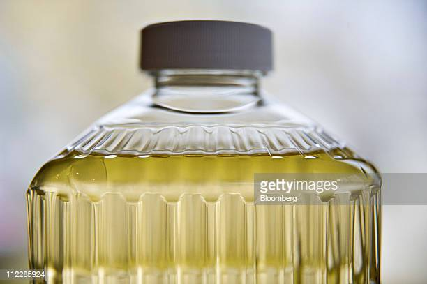 Vegetable cooking oil is displayed for a photograph in Tiskilwa Illinois US on Saturday April 16 2011 At a time when consumers are focused on...