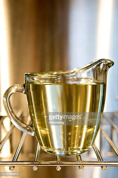 Vegetable cooking oil is displayed in a pitcher for a photograph in Tiskilwa Illinois US on Saturday April 16 2011 At a time when consumers are...