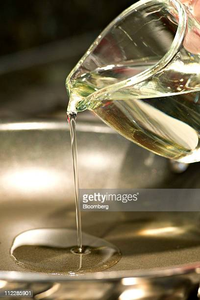 Vegetable cooking oil is poured into a pan on a stove in Tiskilwa Illinois US on Saturday April 16 2011 At a time when consumers are focused on...
