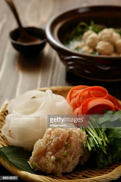Vegetable in basket with pot in background