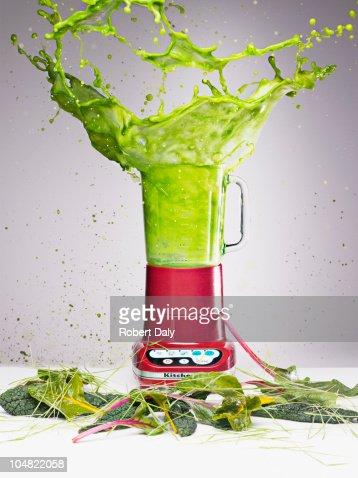 Vegetable juice splashing from blender