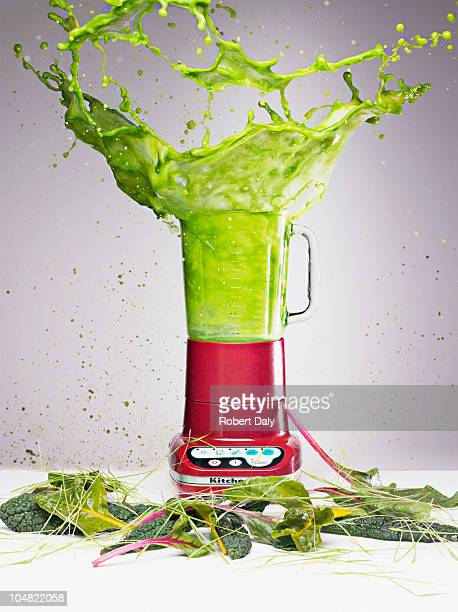 Vegetable juice splashing from blender