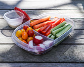 A plastic container with mixed cut vegetables, healthy lunch box, healthy lifestyle concept. Selective focus.