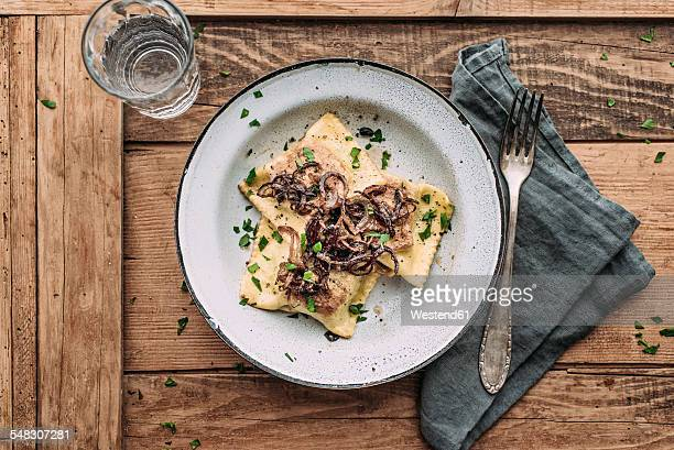 Vegetable ravioli fried in butter with roasted onions