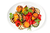Vegetable salad with grilled red capsicum, sweet potato, zucchini and parsley.