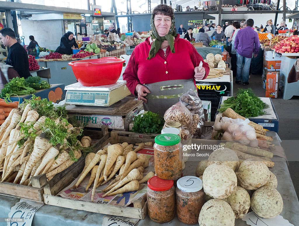 A vegetable seller poses in front of her stall at the daily market on April 15, 2013 in Timisoara, Romania. Romania has abandoned a target deadline of 2015 to switch to the single European currency and will now submit to the European Commission a programme on progress towards the adoption of the Euro, which for the first time will not have a target date.