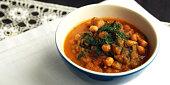 Simple vegetable soup. European cuisine. Chickpeas, potato and carrot. Organic food. Vegan dish. Vegetarian lunch. Wide photo.