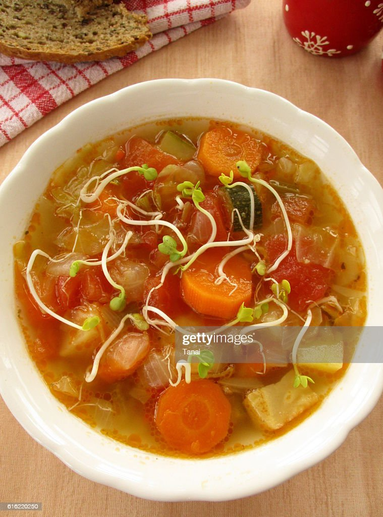 Vegetable soup with sprouts in white bowl : Stockfoto