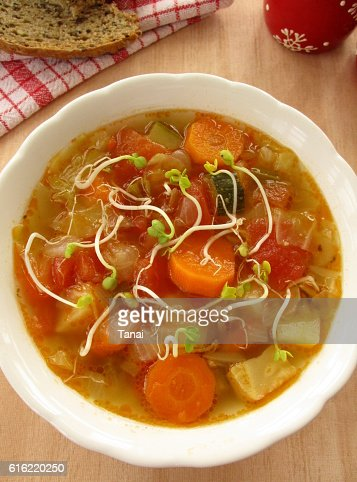 Vegetable soup with sprouts in white bowl : Stock Photo