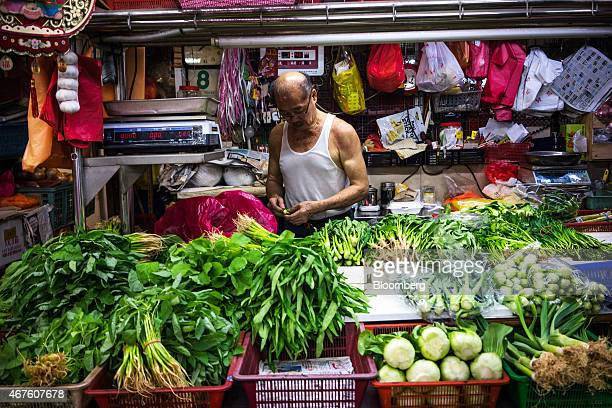 A vegetable vendor cleans produce at a stall in the Tiong Bahru Wet Market in Singapore on Thursday March 26 2015 Lee Kuan Yew Singapore's first...