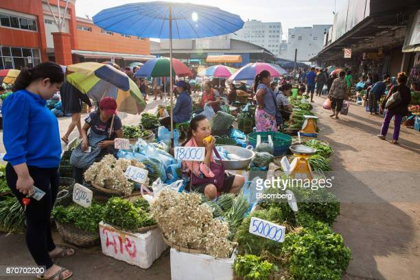 Vegetable vendors wait for customers at a morning market in Vientiane Laos on Thursday Nov 2 2017 Located in the Mekong region Southeast Asia's...