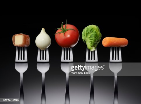 Vegetables and cheese on fork : Stock Photo