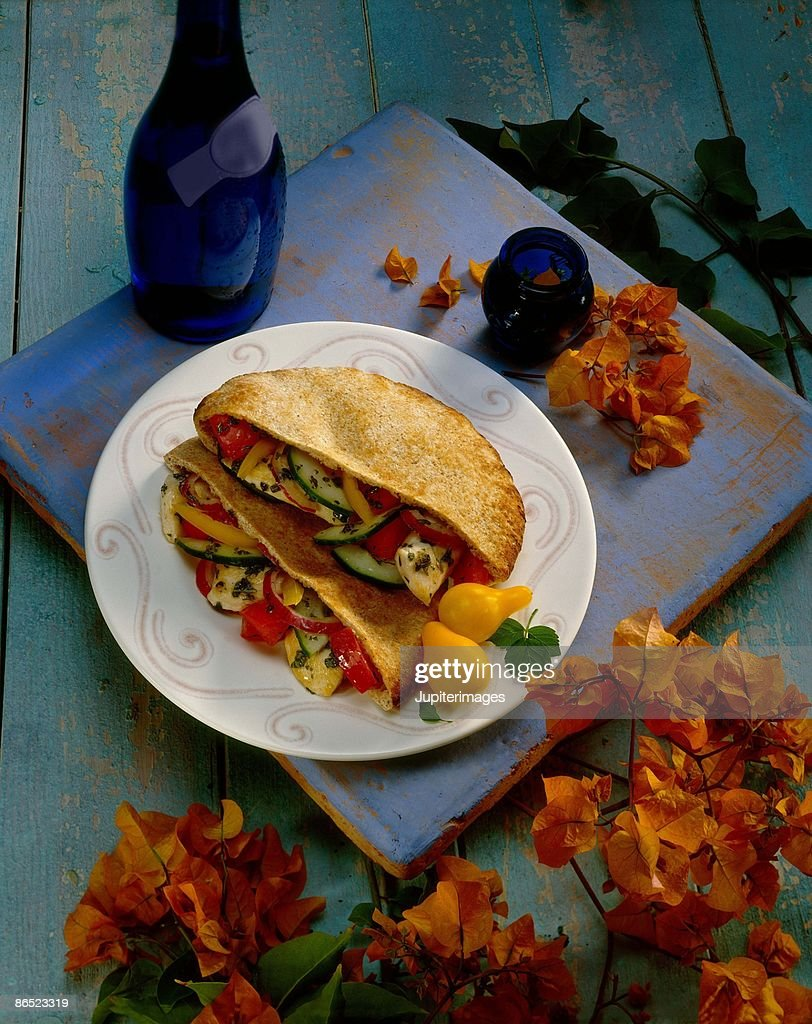 Vegetables and chicken in pita : Stock Photo