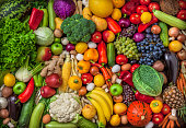 Vegetables and fruits large overhead mix group on colorful background in studio
